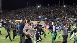 Soccer fans flee from inside the Port Said Stadium on Wednesday. (Reuters)