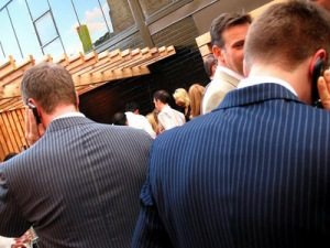 talking-cell-phone-suits-pinstripe-business-businessman-businessmen-shy-hiding (1)