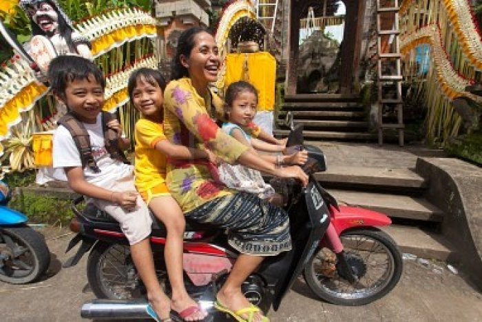 Families of four on a motorcycle.
