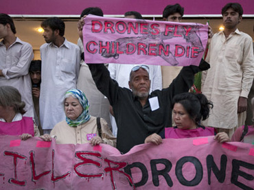 Peace activists from the U.S. hold a banner as they protest against drone attacks in the Pakistani tribal region in Islamabad