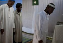 Muslim men stand during Friday prayer service at the Al-Fattah Mosque in Gressier, Haiti. (Photo: Dieu Nalio Chery, AP)