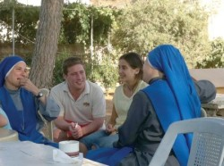 In this recent photo, nuns and foreign volunteers sit for a casual chat outside a church in Arjan, Ajloun, around 80km north of Amman, where they offer education and social services to children from broken families (Photo by Rula Samain)