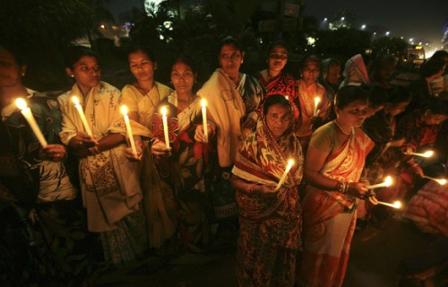 Bhubaneswar_Women hold candles as they participate in a silent protest rally