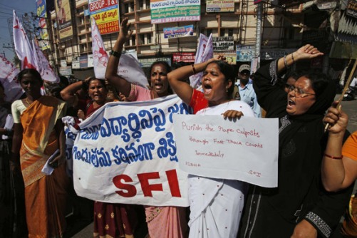 Hyderabad_Activists of All Indian Democratic Women`s Association and Students Federation of India shout slogans during a protest.