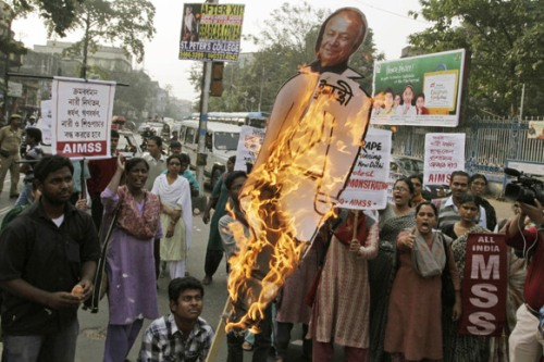 Kolkata_Activists of All India Democratic Students` Organization (DSO) burn a portrait of Indian Minister for Home Affairs Sushil Kumar Shinde during a protest