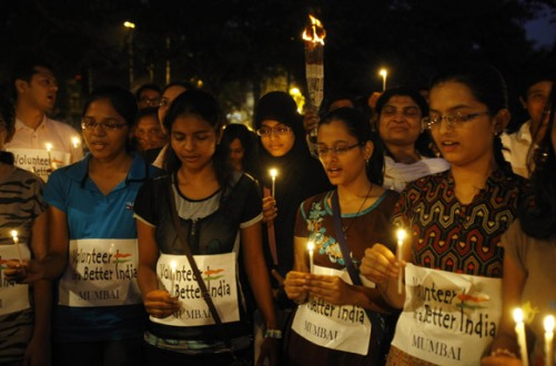 Mumbai_People offer prayers during a candle-light-vigil