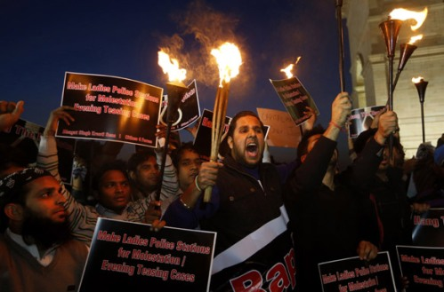 People shout slogans as they stage a torchlight rally near India Gate to demand capital punishment for rapists