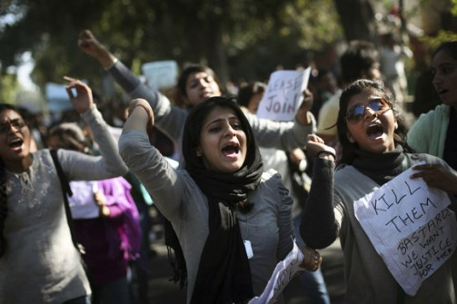 Students shout slogans as they march during a protest in New Delhi