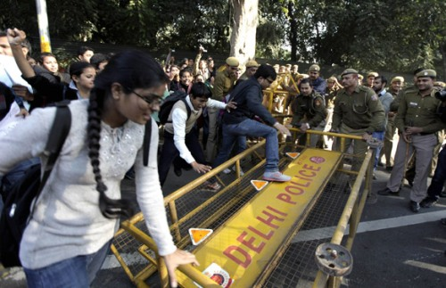 Students try to break through a police barricade to reach the residence of Delhi state government Chief Minister Sheila Dikshit during a protest in New Delhi.