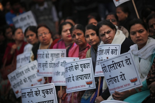 Women supporters hold placards during a protest over the gang rape in New Delhi