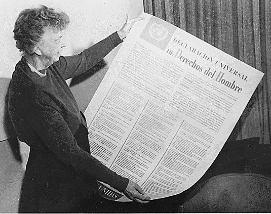 First Lady Eleanor Roosevel with a poster of Universal Declaration of Human Rights