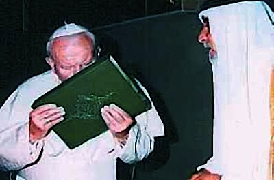 Pope John Paul kissing the Holy Quran