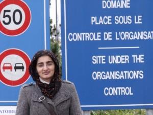 Dr Mansoora Shamim standing in front of the CERN laboratory in Geneva, Switzerland
