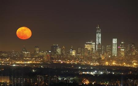 A full moon rises over the skyline of New York, as seen from the Eagle Rock Reservation in West Orange, New Jersey