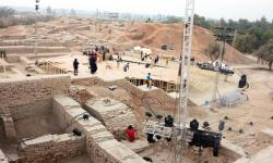 Pakistani workers prepare a stage around the ancient ruins ahead of the cultural heritage festival in Mohenjo Daro, the UNESCO World Heritage site around 425 kilometers north of the port city of Karachi, on January 30, 2014. (AFP)