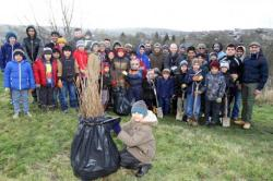 Keighley News: Members of the Ahmadiyya Muslim community gather, above, to plant trees near the Braithwaite estate