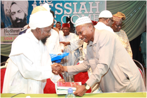 Amir Sahib Nigeria presenting a copy of Invitation to Ahmadiyya and other books to a Senior Officer at the Lagos State Ministry of Education, Alhaji AbdulFatah Abiola Oladejo during the Anniversary