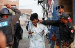 A Christian is beaten by Pakistani police. (Photo © Reuters)