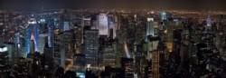 New_York_Midtown_Skyline_at_night_-_Jan_2006_edit1-300x104