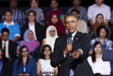 Obama pointing to a student for a question during the Young Southeast Asian Leadership Initiative town hall meeting at the University of Malaya in Kuala Lumpur April 27, 2014.