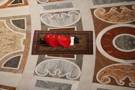 Pope Francis lies on the ground during the celebration of the Passion of Christ on Good Friday at Saint Peter's basilica, at the Vatican, April 18. On Good Friday Christians commemorate the crucifixion of Jesus Christ. (STEFANO RELLANDINI/EPA) Week of observances