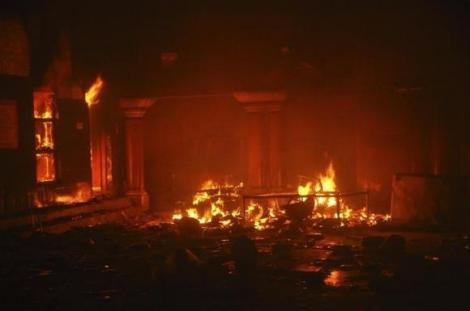 A Hindu temple burns after it was attacked in Larkana, southern Pakistan's Sindh province, March 15, 2014.  REUTERS/Faheem Soormro/Files