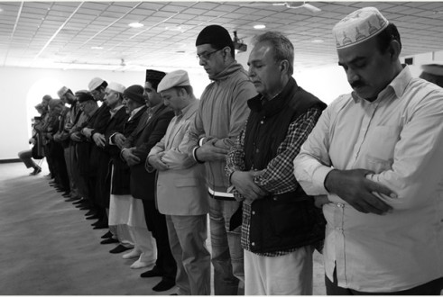 Mr Ahmad Sharif is head of the Shirley branch of the Ahmaddiya Muslim group. The group i slooking for a new base somewhere in Croydon.   image: L to R  Mr Ahmad Sharif(front) with other members in Mosque Picture Credit Grant Melton/copyright