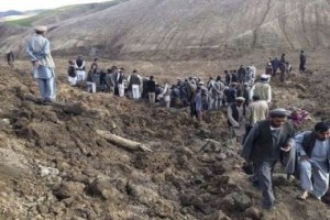 Afghan villagers gather at the site of a landslide at the Argo district in Badakhshan (reuters tickers)
