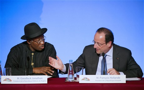 Goodluck Jonathan, left, and Francois Hollande speak to the press following the summit on Boko Haram (AFP/GETTY)