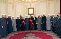 Sunni Muslim Mufti of Lebanon Mohammed Rashid Qabbani (seventh left), poses for a photograph next to Maronite Patriarch Bishara al-Rai at the See of the Maronite Catholic Patriarchate in Bkerke in May 2014. [Anwar Amro/AFP]