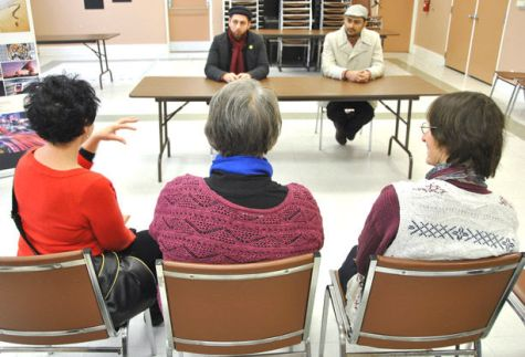 Rezwan Muhammad (background at left) and Shakoor Ahmad of the Ahmadiyya Muslim Youth Association led a Holy Quaran exhibition and open house Saturday afternoon at the Stratford Public Library aimed to educate the public about Islam in light of recent global events. CORY SMITH/The Beacon Herald