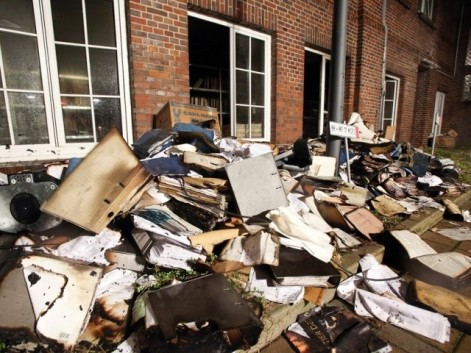 Burnt and damaged files are seen in the courtyard of German regional newspaper Hamburger Morgenpost editorial office in Hamburg, northern Germany, on January 11, 2015 after an arson attack. PHOTO: AFP