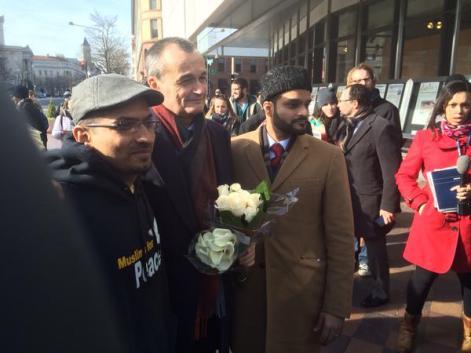 Members of the Ahmadiyya Muslim Youth Association offer flowers/condolences to French Ambassador Araud.