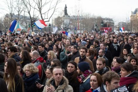 People at Place de la République take part in the Unity March in Paris. (Photograph by Nick Kozak)