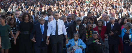 Obama leading a parade to celebrate Selma
