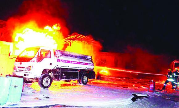 RAVE: A Civil Defense officer drove a burning diesel truck a safe distance away from a transport company's offices in Shumaisi to protect lives and property. (Al-Riyadh photo)