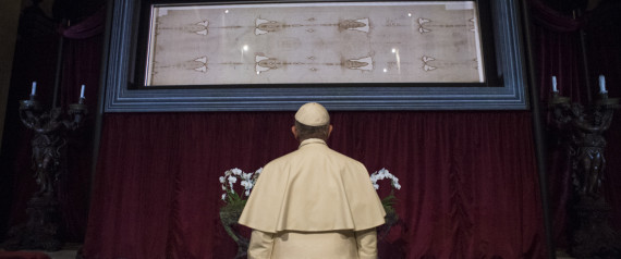 In this pool photo taken Sunday, June 21, 2015, and made available Monday, June 22, Pope Francis prays in front of the Holy Shroud, the 14 foot-long linen revered by some as the burial cloth of Jesus, on display at the Cathedral of Turin, Italy, Sunday, June 21, 2015. Francis visited the long linen with the faded image of a bearded man, during his two-day pilgrimage to Turin. (L' Osservatore Romano/Pool Photo via AP)