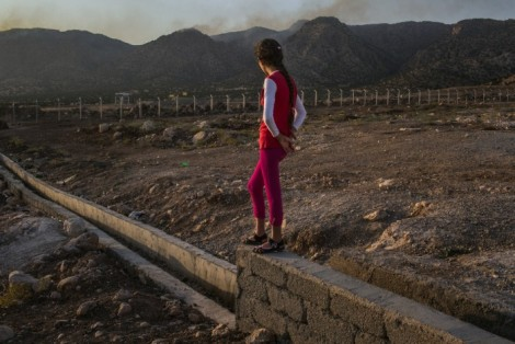 Photograph of a Yazidi girl by MAURICIO LIMAAUG, from New York Times' article