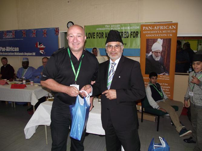 Sgt Martin Hewwet recieving Eid Gift