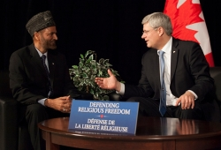 Former Prime Minister Stephen Harper with Lal Khan Malik, national president of Ahmadiyya Muslim Jama'at Canada
