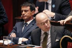 French Prime Minister Manuel Valls (L) and Interior Minister Bernard Cazeneuve attend a debate at the National Assembly in Paris, France, November 19, 2015. REUTERS/Charles Platiau