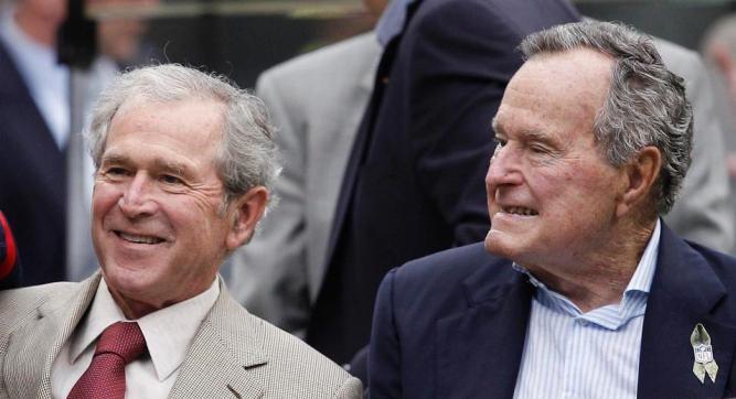 George H.W. Bush and his son George W Bush in 2014