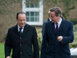 Prime Minister David Cameron walking with French President Francois Hollande