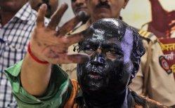 Sudheendra Kulkarni, head of an Indian think tank, was doused with ink by Hindu radicals. Credit Divyakant Solanki/European Pressphoto Agency