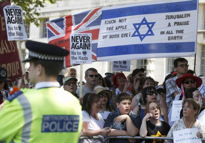 People of multiple faiths hold a counter-protest to an anti-Shomrim protest that was held to demonstrate against Britain's Jewish community in Westminster, London