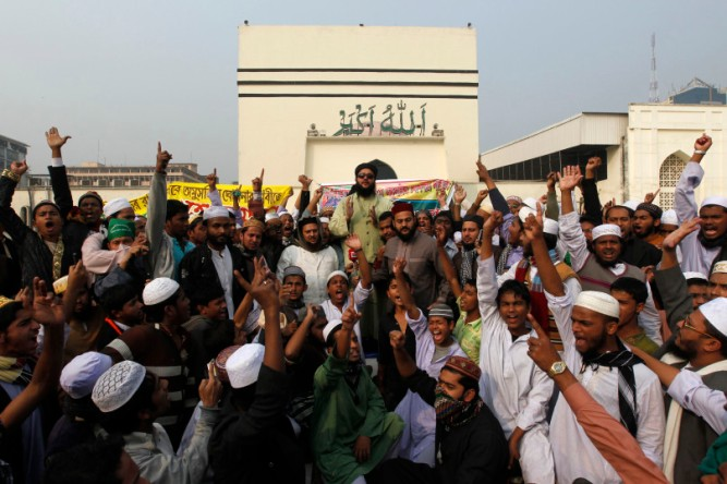 Members of Tehreek-e-Khatme Nabuwwat, a radical Islamist group shout slogans as they demand to declare the Ahmadiyya Muslim Community non Muslims in front of the national mosque in Dhaka.