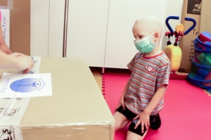 A sick child looking for donated items