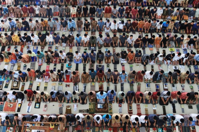 Students pray at Ar-Raudhatul Hasanah Islamic boarding school on the first day of Ramadan in Medan, North Sumatra
