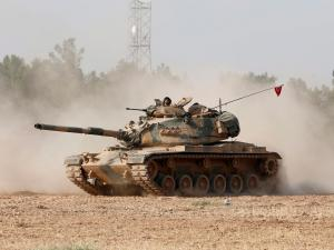 Turkish tanks on their way to the Turkish-Syria border during an operation against Isis on 24 August 2016. EPA