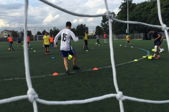 oys play soccer on a field in west London in August. They are members of the counter-radicalization soccer club TUFF FC, which was originally founded to give children in the district of Southall an affordable opportunity to practice. (Rick Noack/The Washington Post)